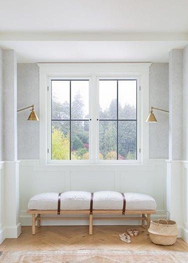 white hallway with simple window bench under a window