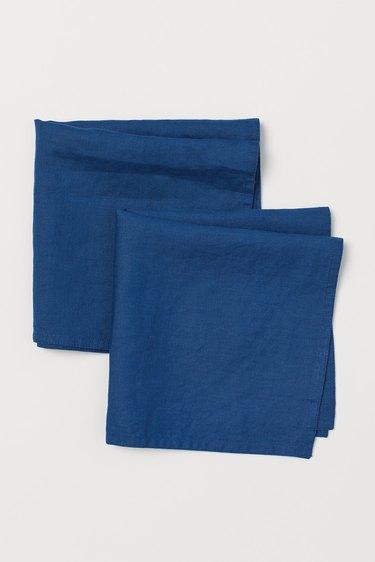 two dark blue linen napkins