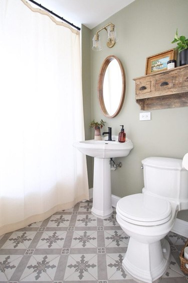 Minimalist bathroom with sage color walls and patterned floor tile