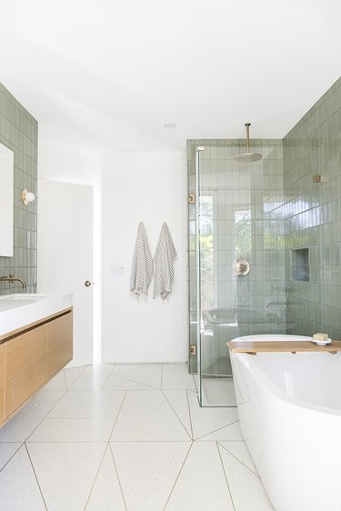Contemporary bathroom with white floor tile and sage color shower tile