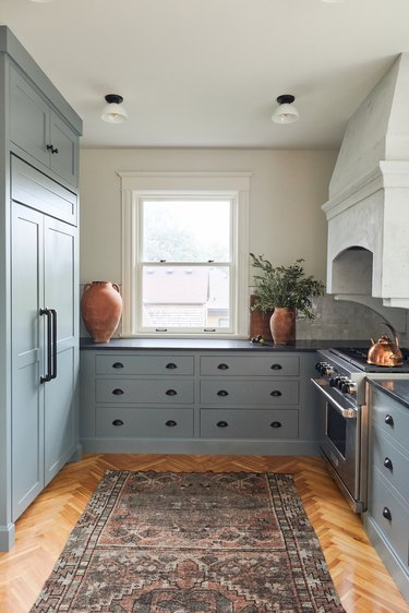 Dusty blue kitchen colors on cabinets in galley kitchen