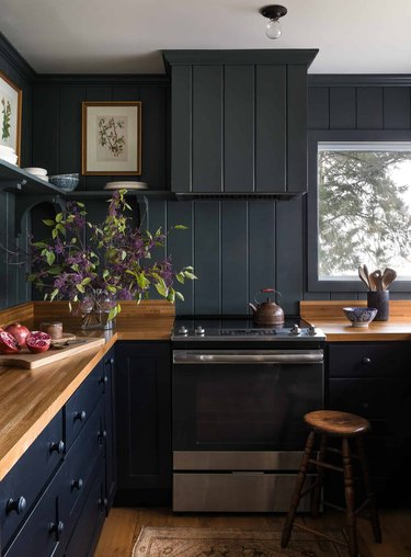 dark painted kitchen colors in kitchen with butcher block counter