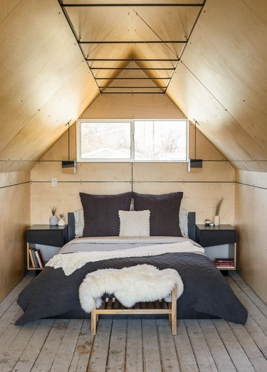 small bedroom with birch panels