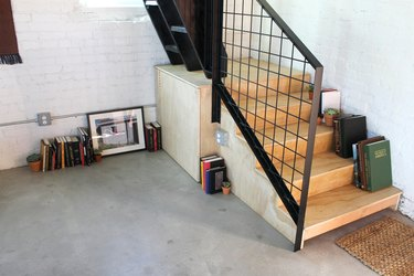 metal staircase railing and concrete floors