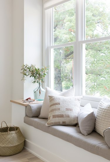 built-in window seat with accent pillows