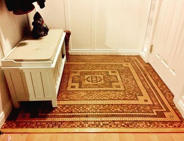 entryway with floor made out of pennies