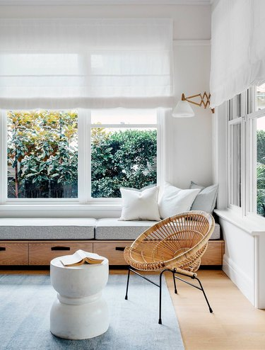 white sunroom with minimalist window bench with built-in drawers