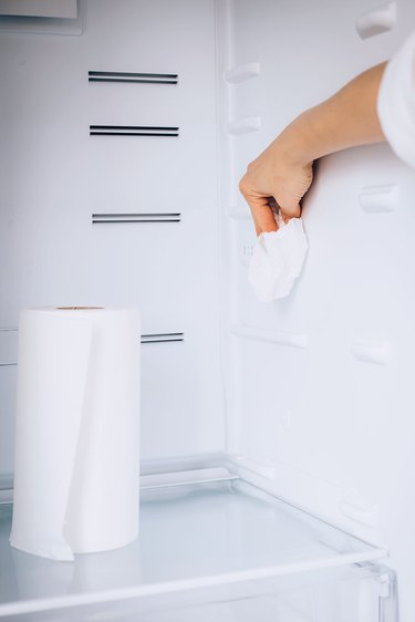 Rinsing and drying the fridge after cleaning