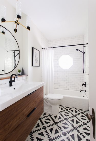 Modern bathroom featuring black and white accents