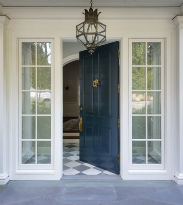 blue traditional front doors with gloss and brass door knocker