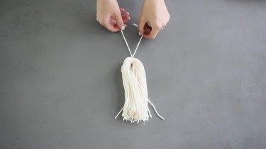 Folding the yarn strands in half