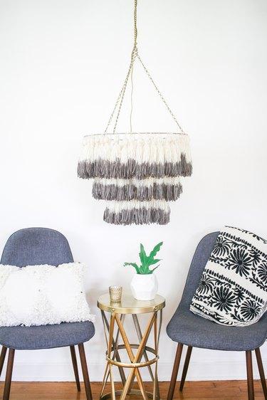 Dip-dyed tassel chandelier hanging in living room