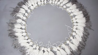 Tassels tied around circumference of large hoop