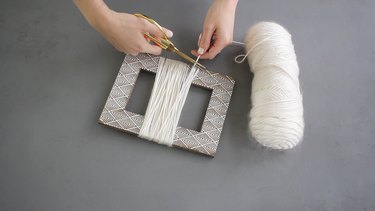 Yarn wrapped around empty picture frame