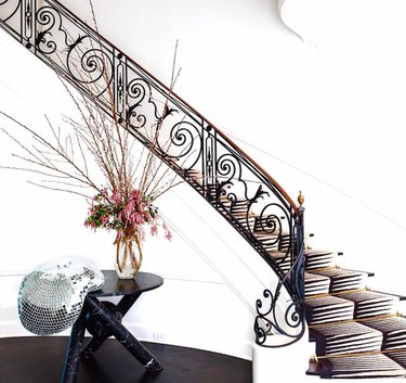 ornate black stair railing for maximalist staircase