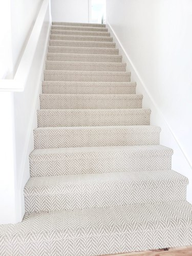 neutral stair carpet idea with houndstooth pattern in white staircase