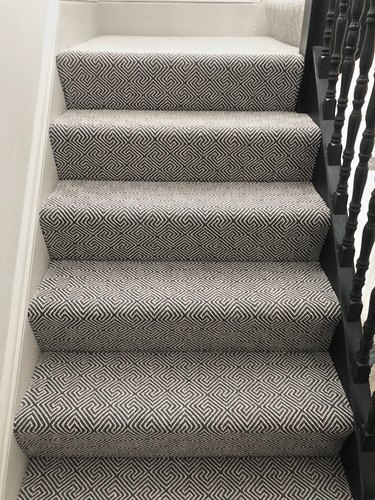 gray stair carpet idea with black railing