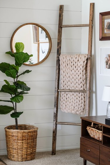 white nook with diy rustic decor wooden ladder and throw blankets