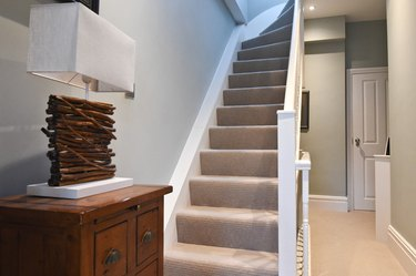 neutral stair carpet idea with white railing