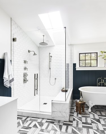 Large white modern bathroom shower idea with blue wainscoting and patterned tile floor