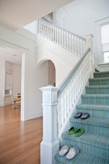 colorful striped stair carpet idea with white staircase