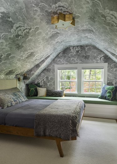 Cloud-covered pitched roof bedroom wallpaper idea