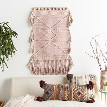 blush room decor wall hanging by Jungalow