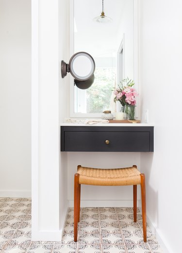 patterned bathroom floor tile idea with floating black vanity and white walls