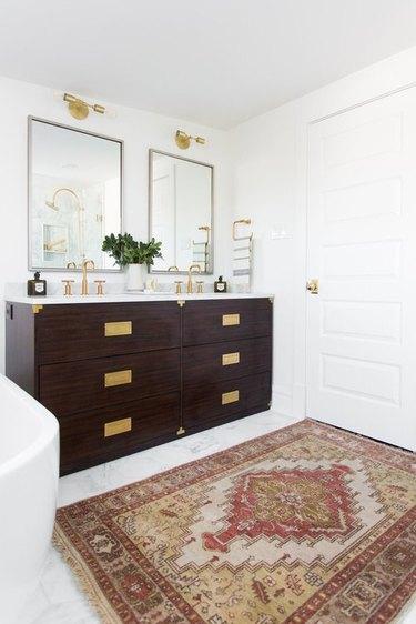 campaign style dresser as bathroom vanity idea with area rug on floor