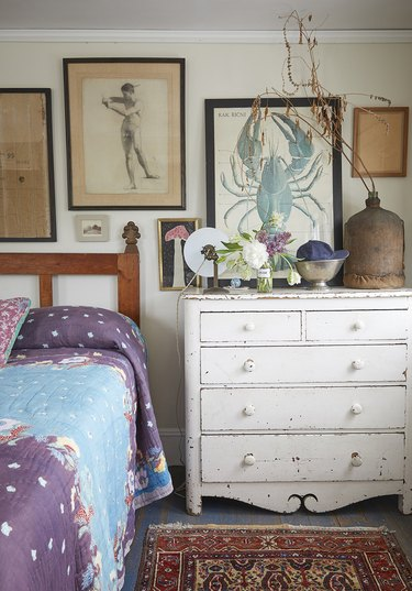 rustic beach decor in bedroom with white dresser and framed art