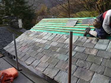 Installing a slate roof in the British countryside
