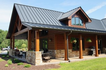 Standing seam metal roof on log cabin.