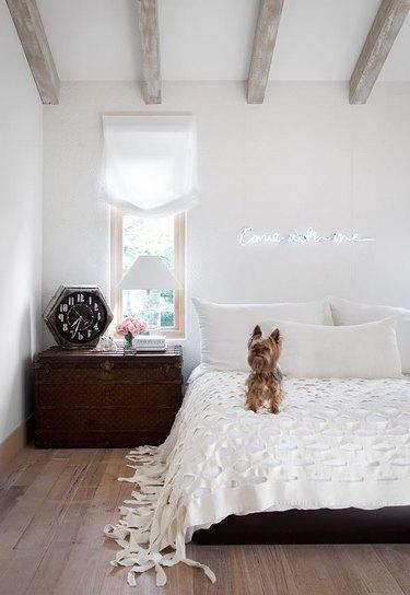 neon sign in rustic white bedroom