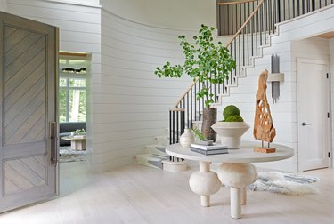 whitewashed hardwood floor colors in entryway with staircase and white shiplap