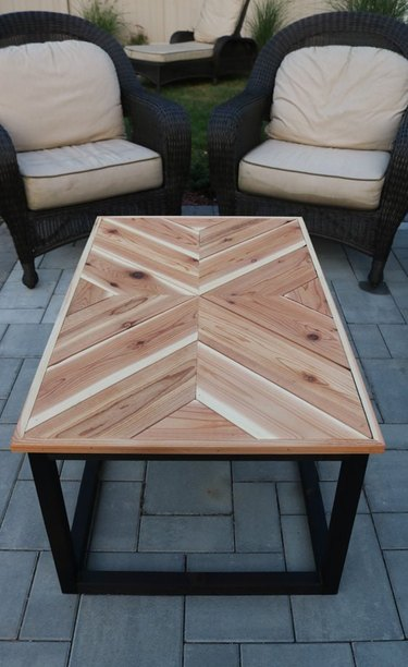 DIY rustic coffee table with wood chevron tabletop on patio