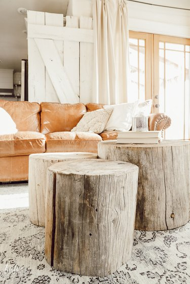 DIY rustic coffee tables in grouping of three tree stumps