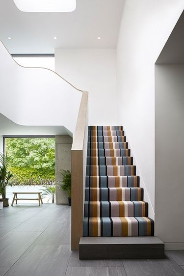 striped stair carpet idea in modern home