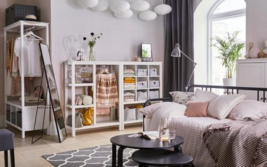 bedroom storage idea IKEA open wardrobe full of bins and purses