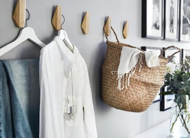 bedroom storage idea with wall hooks from IKEA