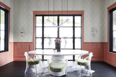 pink dining room idea with wainscoting and retro furniture