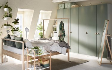 bedroom storage idea with IKEA bed frame as clothing rack