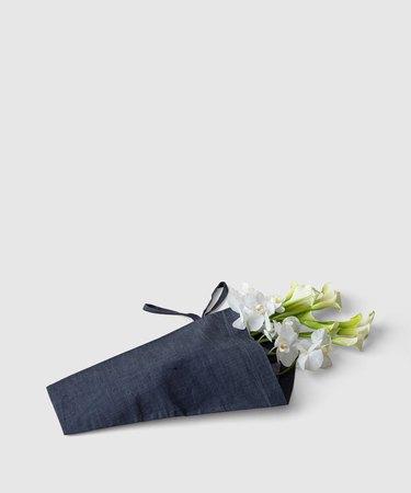 flowers in denim tote