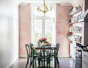 pink dining room in country kitchen with green chairs and table