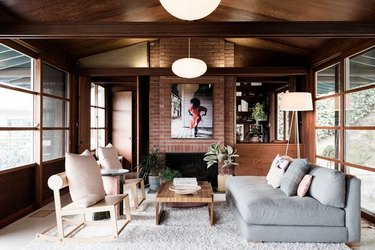 midcentury living room with dark wood accents and light-toned furniture