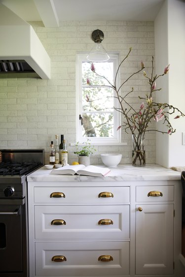 traditional kitchen lighting with sconce near window