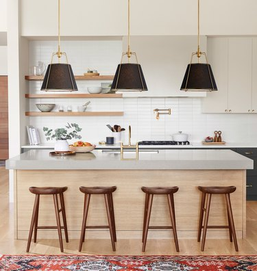 traditional kitchen lighting with linen shade and brass accents