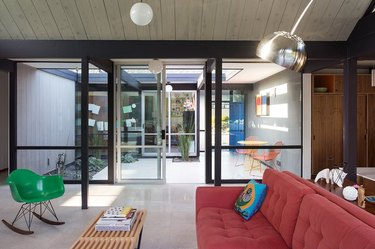 midcentury living room and breezeway with classic, colorful furnishings