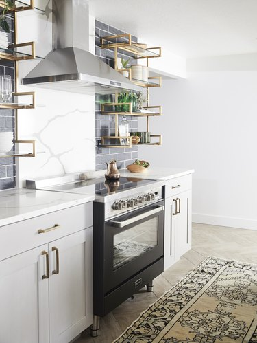 modern kitchen idea with marble backsplash and black accents