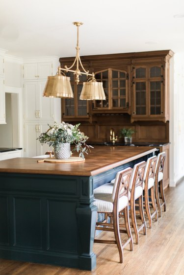 traditional kitchen lighting with brass fixture over island