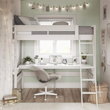 bedroom office idea with white loft bed with a desk underneath, in a light green bedroom